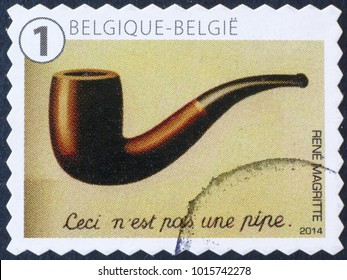 Milan, Italy - January 27, 2018: Famous surrealistic painting by Magritte on postage stamp