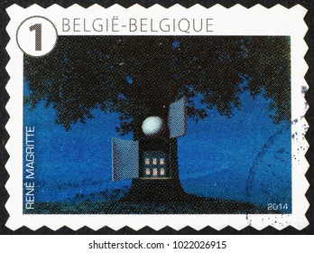 Milan, Italy - January 27, 2018: Surrealistic painting by Magritte on belgian postage stamp