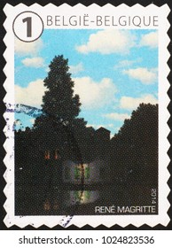 Milan, Italy - January 27, 2018: Famous painting by Magritte on postage stamp