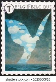 Milan, Italy - January 27, 2018: Surrealistic painting by Magritte on belgian stamp