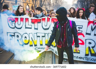 MILAN, ITALY - JANUARY 29: students demonstrating against racism, fascism and the meeting between Marie Le Pen and Matteo Salvini on Milan on January 29, 2016. A masked student holding a smoke pot.