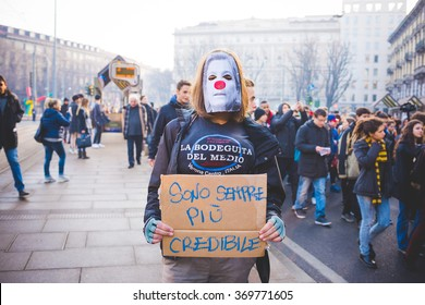 """MILAN, ITALY - JANUARY 29: students demonstrating against the meeting between Marie Le Pen and Matteo Salvini on Milan on January 29, 2016. Student masked with banner saying """"I'm more credible anyway"""""""