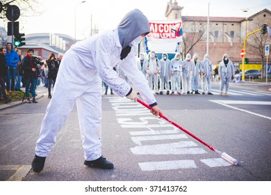 """MILAN, ITALY - JANUARY 29: students demonstrating against meeting between Marie Le Pen and Matteo Salvini in Milan on January 29, 2016. Student dressed like esterminator writing """"Never with Salvini"""""""