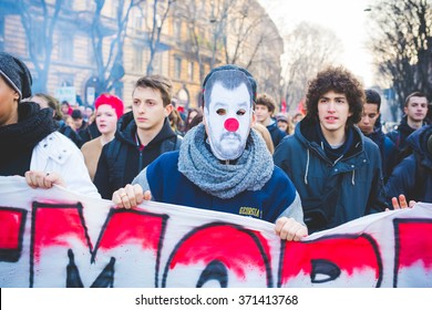MILAN, ITALY - JANUARY 29: students demonstrating against the meeting between Marie Le Pen and Matteo Salvini in Milan on January 29, 2016. Student masked with mask rappresenting Salvini with red nose