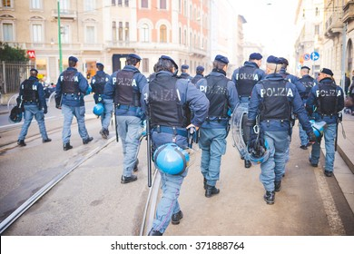 MILAN, ITALY - JANUARY 29: students demonstrating against the meeting between Marie Le Pen and Matteo Salvini on Milan on January 29, 2016. Rear view policemen trying to maintain public order