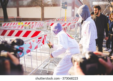 MILAN, ITALY - JANUARY 29: students demonstrating against the meeting between Marie Le Pen and Matteo Salvini on Milan on January 29, 2016. Protester wearing exterminator mask writing on barricades