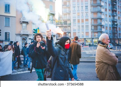MILAN, ITALY - JANUARY 29: Students demonstrating against the meeting between Marie Le Pen and Matteo Salvini in Milan on January 29, 2016. Student masked holding smoke bomb