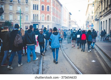 MILAN, ITALY - JANUARY 29: Students demonstrating against the meeting between Marie Le Pen and Matteo Salvini in Milan on January 29, 2016. Rear view of crowd marching against racism, fascism and sessism