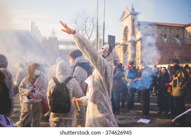 MILAN, ITALY - JANUARY 29: students demonstrating against the meeting between Marie Le Pen and Matteo Salvini on Milan on January 29, 2016. Protester dressed like exterminator launching a smoke pot