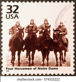 Milan, Italy - January 30, 2017: Four horsemen of Notre Dame on postage stamp