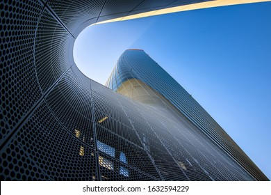 MILAN, ITALY - JANUARY 31, 2020: Skyscraper Generali Tower designed by Zaha Hadid architects, headquarter of the Generali Group's in Milan at commercial and residential CityLife district area