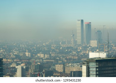 Milan, Italy - January 6, 2019: Milan landscape with smog, aerial view of the city with polluted air.