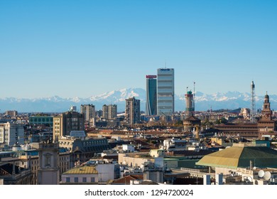 Milan, Italy - January 6, 2019: City skyline. Panoramic view of Milano city with the new skyscrapers in CityLife district. Italian Alps and Monte Rosa mountain range in the background.
