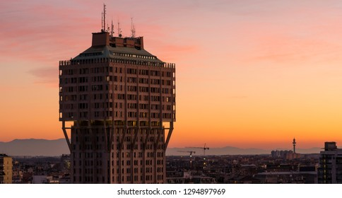 Milan, Italy - January 6, 2019: Urban landscape at sunset. Milan skyline with Velasca Tower (Torre Velasca). This famous skyscraper, approximately 100 metres tall, was built in the fifties.
