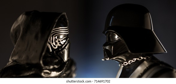 Milan, Italy - January 9, 2016: Darth Vader and Kylo Ren facing each other on a dark background.