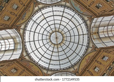 Milan, Italy - July 09, 2013: Skylight Dome and Golden Frescos at Oldest Shopping Mall Arcade Galleria Vittorio Emanuele II in Milan, Italy.