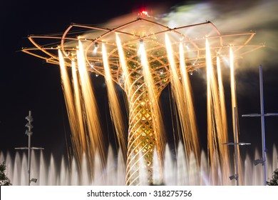 MILAN, ITALY - JULY 11, 2015: Long exposure night photo of the beautiful light and water fountain and fireworks show from the Tree of Life (Albero della vita in Italian), the symbol of Expo 2015 area.