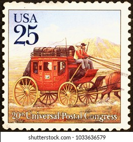 Milan, Italy - July 11, 2016: Old stagecoach on american postage stamp