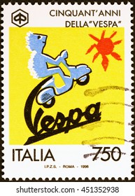 Milan, Italy - July 11, 2016: Fiftieth of Vespa on italian postage stamp