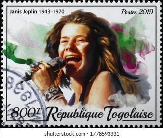 Milan, Italy - July 17, 2020: Janis Joplin at Woodstock on postage stamp of Togo