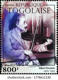Milan, Italy - July 17, 2020: Albert Einstein playing the violin on postage stamp