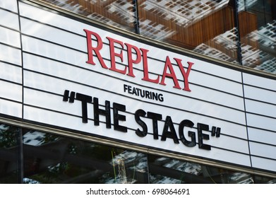 MILAN, ITALY - JULY 19, 2017: Replay signoboard store in Gae Aulenti square in Milan, Italy. Replay is an Italian brand, one of the leaders in the world of men's and women's denim clothing.