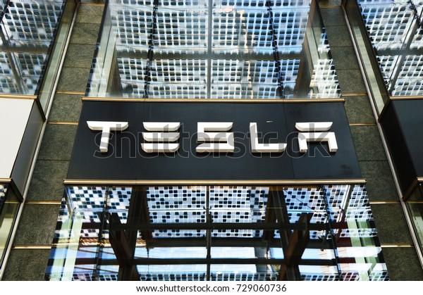MILAN, ITALY - JULY 19, 2017: Tesla Motors store in Piazza Gae Aulenti square in Milan, Italy