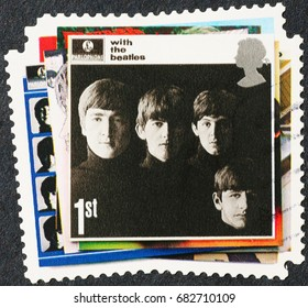 Milan, Italy - July 20, 2017: Cover of old Beatles record on postage stamp