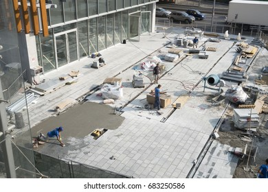 Milan, Italy - July 22, 2017: Workers work at the outside floor of the Coima offices in Porta Nuova Varesine district.