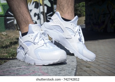Milan, Italy - July 22, 2017: Nike Huarache shoes in the street - illustrative editorial