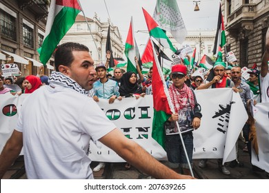 MILAN, ITALY - JULY 26: People march and protest against Gaza strip bombing in solidarity with Palestinians on JULY 26, 2014 in Milan.