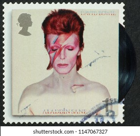 Milan, Italy - July 27, 2018:  Cover of LP Aladdin Sane on postage stamp