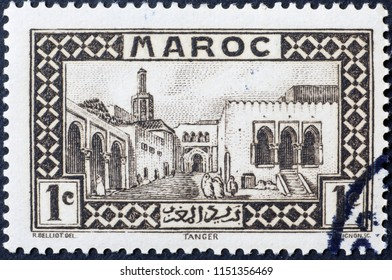 Milan, Italy - July 27, 2018: Cityscape of Tanger on ancient moroccan postage stamp