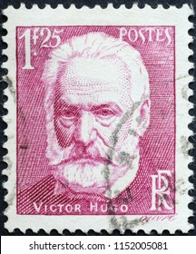 Milan, Italy - July 27, 2018: Victor Hugo on old french postage stamp