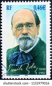 Milan, Italy - July 27, 2018; Novelist Emile Zola on french postage stamp