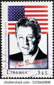 Milan, Italy - July 27, 2018: President William Clinton and flag on postage stamp