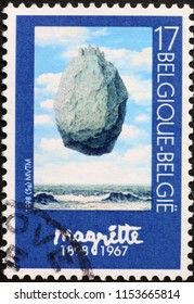 Milan, Italy - July 27, 2018: Masterpiece by Magritte on postage stamp of Belgium