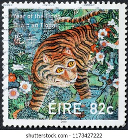 Milan, Italy – July 27, 2018: Tiger painted by Rousseau on irish postage stamp
