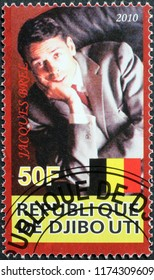 Milan, Italy – July 27, 2018: Jacques Brel portrait on postage stamp