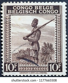Milan, Italy – July 27, 2018: Soldier on old postage stamp of Belgian Congo