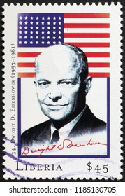 Milan, Italy – July 27, 2018: President Dwight Eisenhower and flag on postage stamp