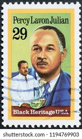 Milan, Italy – July 27, 2018: Black heritage, Percy Lavon Julian on american stamp