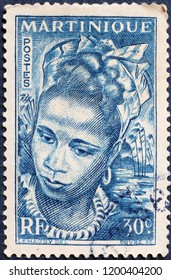 Milan, Italy – July 27, 2018: Portrait of a woman on vintage stamp of Martinique