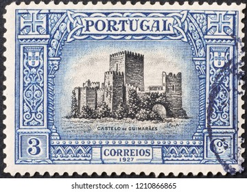 Milan, Italy – July 27, 2018: Castle of Guimaraes on portuguese postage stamp