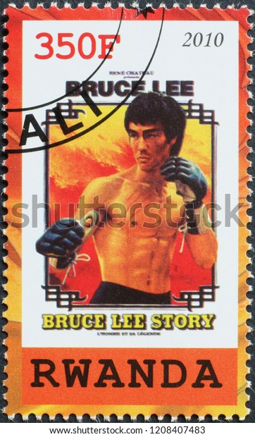 Milan, Italy – July 27, 2018: Movie poster with Bruce Lee on stamp of Rwanda
