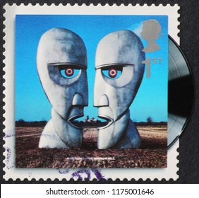 Milan, Italy – July 28, 2018: Cover of The Division Bell by Pink Floyd on stamp