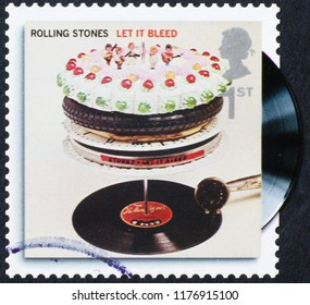 Milan, Italy – July 28, 2018: Cover of Let it bleed by of Rolling Stones on stamp
