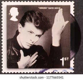 Milan, Italy – July 28, 2018: Cover of Heroes by David Bowie on postage stamp