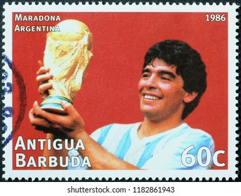 Milan, Italy – July 28, 2018: Maradona with World Cup trophy on postage stamp