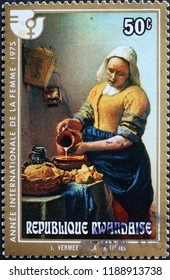 Milan, Italy – July 28, 2018: Painting The Milkmaid by Vermeer on postage stamp